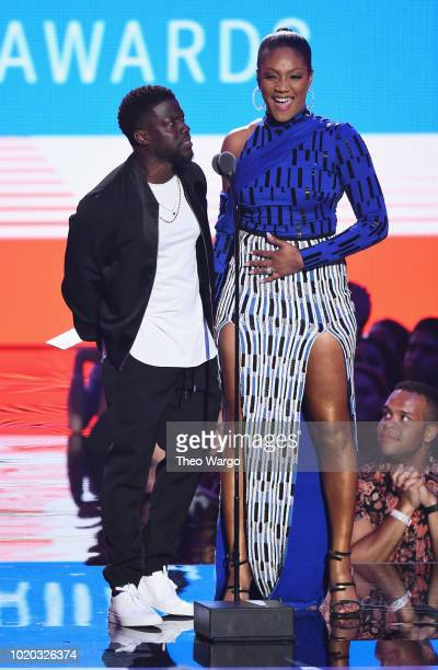 Kevin Hart and Tiffany Haddish speak onstage during the 2018 MTV Video Music Awards at Radio City Music Hall on August 20 2018 in New York City
