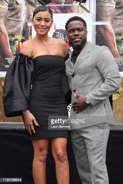 Kevin Hart and wife Eniko Parrish pose as Hart is honored with a Hand And Footprint Ceremony at TCL Chinese Theatre on December 10 2019 in Hollywood...