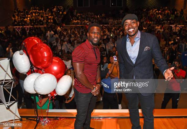 Kevin Hart and Will Packer onstage during Night School Office Depot Surprise Donation at Langston Hughes High School on September 11 2018 in Fairburn...