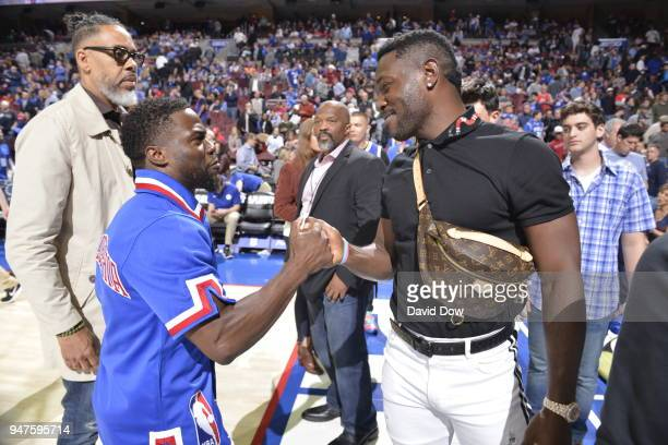 Kevin Hart greets Antonio Brown greet each other after the game between Miami Heat and Philadelphia 76ers in Game Two of Round One of the 2018 NBA...