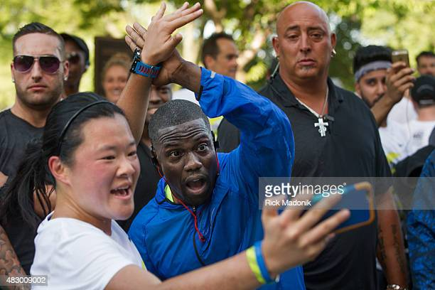 TORONTO ONTARIO AUGUST 2 2015 Kevin Hart greets runners finishing the run with high fives and some sneak a selfie in American comedian and actor...