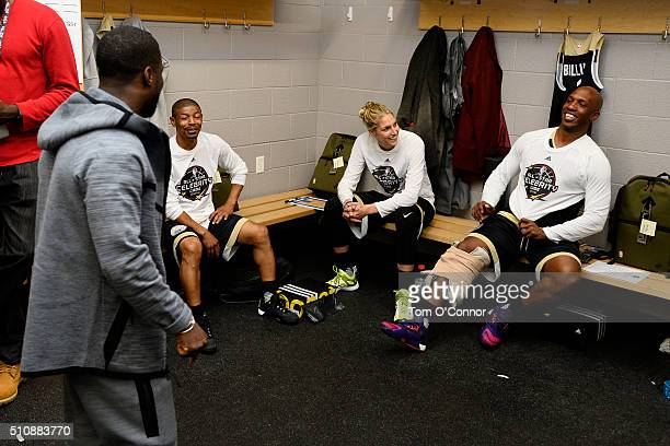 Kevin Hart Muggsy Bogues Elena Delle Donne and Chauncey Billups in the locker room before the NBA AllStar Celebrity Game Presented by Mountain Dew as...