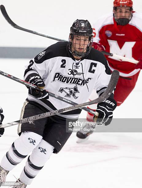 Kevin Hart of the Providence College Friars looks for a pass during NCAA hockey action against the Miami University RedHawks at the Schneider Arena...