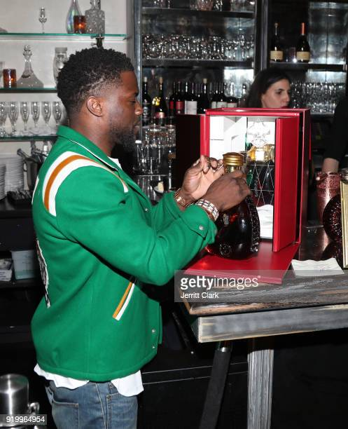Kevin Hart opens a bottle of Louis XIII at the Klutch Sports Group More Than A Game Dinner Presented by Remy Martin at Beauty Essex on February 17...