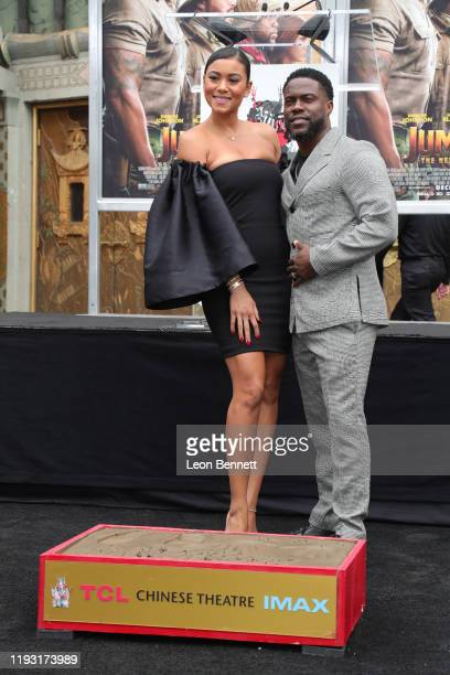 Kevin Hart poses with his wife Eniko Parrish as he is honored with a Hand and Footprint ceremony at the TCL Chinese Theatre IMAX on December 10 2019...