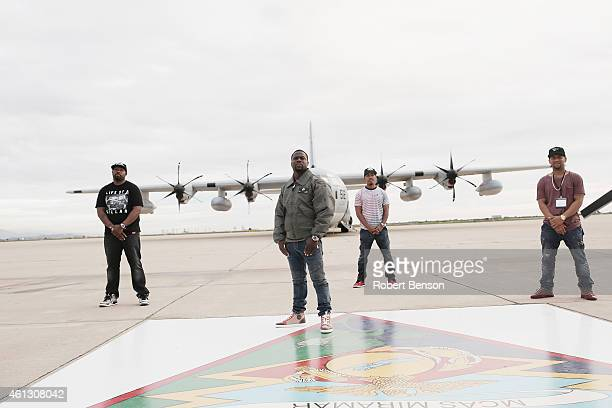Kevin Hart stands with friends during a base tour and a special screening of Screen Gems' 'The Wedding Ringer' at Marine Corps Air Station Miramar's...