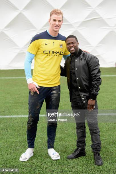 Kevin Hart star of 'Ride Along' makes a visit to the Manchester City FC training ground at Carrington where he met Joe Hart on February 26 2014 in...