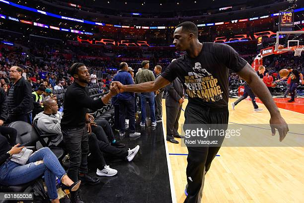 Kevin Hart talks to Brandon Bass at a basketball game between the Oklahoma City Thunder and the Los Angeles Clippers at Staples Center on January 16...