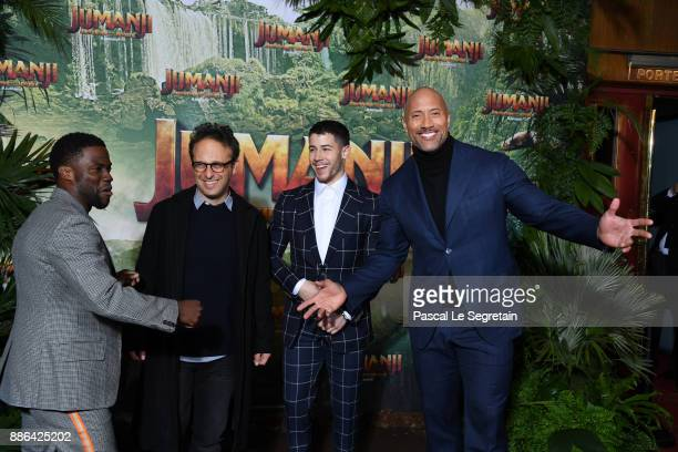Kevin HartJake Kasdan Nick Jonas and Dwayne Johnson attend 'Jumanji Welcome to the Jungle' Premiere at Le Grand Rex on December 5 2017 in Paris France