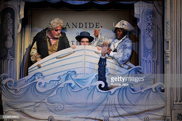 Kevin Harvey as JacquesIan Redford as PanglossCiaran Owens as a Sailor and Dwane Walcott as CandideThe Actor in the Royal Shakespeare Company's...