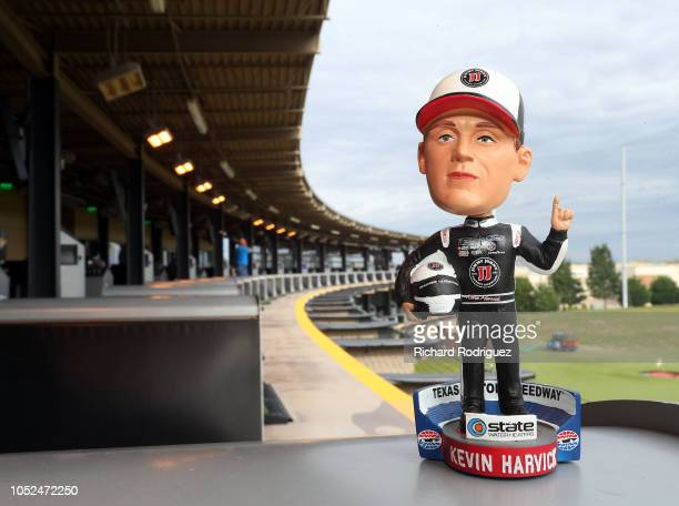 Kevin Harvick bobblehead sits on a ball dispenser before the start of an event featuring Kevin Harvick at Topgolf on October 18 2018 in Allen Texas