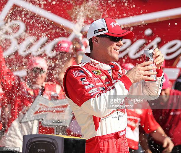 Kevin Harvick celebrates in Victory Lane after winning the Budweiser Duel at Daytona International Speedway in Daytona Beach Florida Thursday...