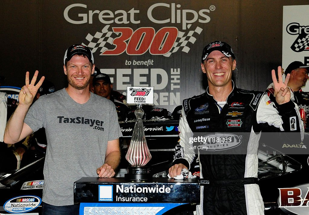 Kevin Harvick, driver of the #5 Bad Boy Buggies Chevrolet, and Dale Earnhardt Jr., owner of Jr. Motorsports, pose with the trophy in Victory Lane after winning the NASCAR Nationwide Series Great Clips 300 at Atlanta Motor Speedway on August 30, 2014 in Hampton, Georgia.