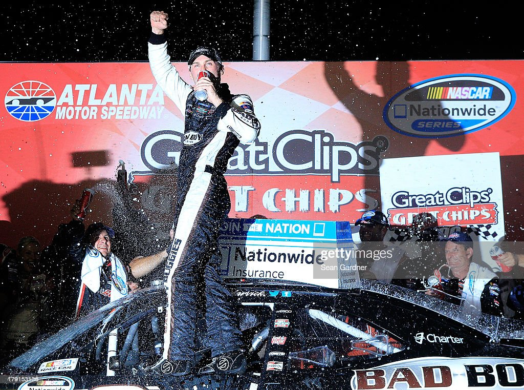 Kevin Harvick, driver of the #33 Bad Boy Buggies Chevrolet, celebrates in victory lane after winning the NASCAR Nationwide Series Great Clips/Grit Chips 300 at Atlanta Motor Speedway on August 31, 2013 in Hampton, Georgia.