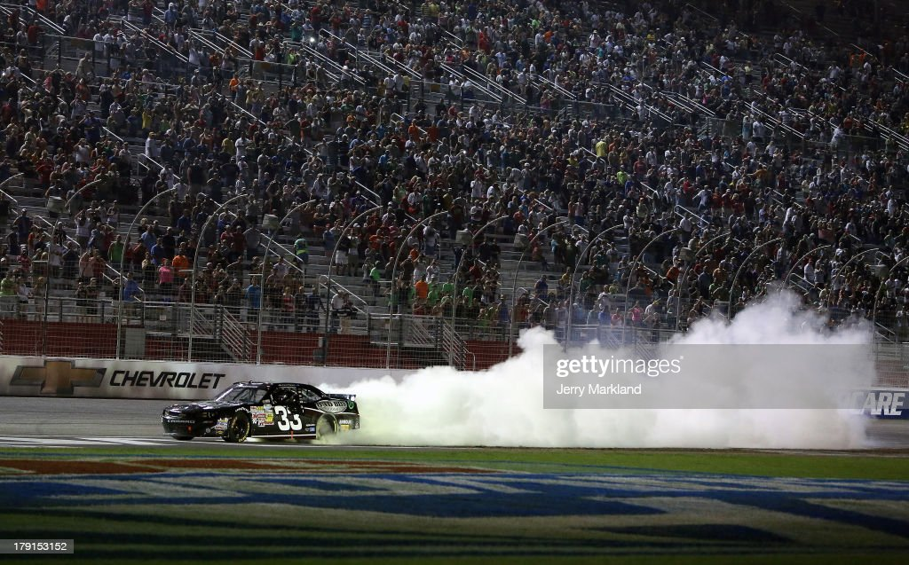 Kevin Harvick, driver of the #33 Bad Boy Buggies Chevrolet, celebrates with a burnout after winning the NASCAR Nationwide Series Great Clips/Grit Chips 300 at Atlanta Motor Speedway on August 31, 2013 in Hampton, Georgia.