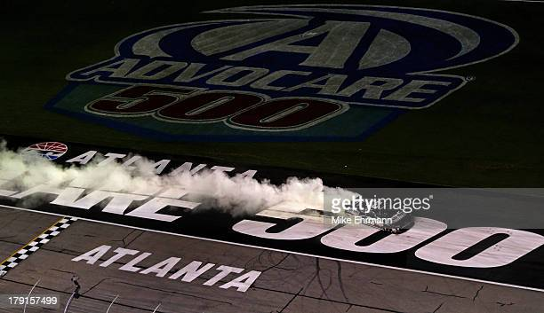 Kevin Harvick driver of the Bad Boy Buggies Chevrolet celebrates with a burnout after winning the NASCAR Nationwide Series Great Clips/Grit Chips 300...