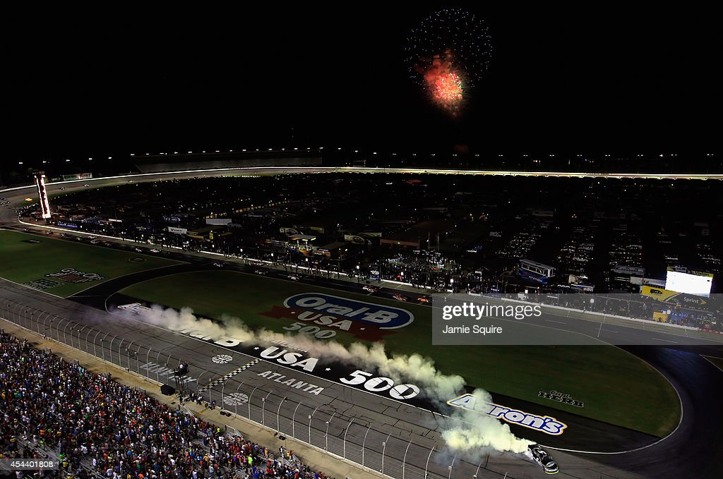 Kevin Harvick, driver of the #5 Bad Boy Buggies Chevrolet, celebrates with a burnout after winning the NASCAR Nationwide Series Great Clips 300 at Atlanta Motor Speedway on August 30, 2014 in Hampton, Georgia.