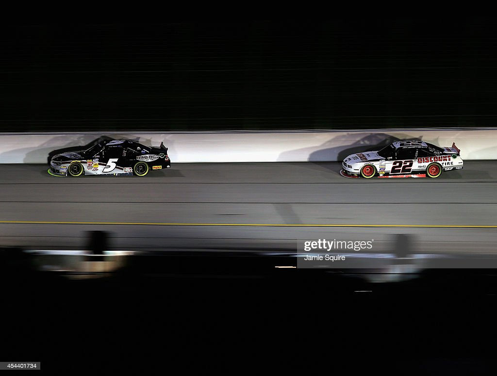 Kevin Harvick, driver of the #5 Bad Boy Buggies Chevrolet, leads Joey Logano, driver of the #22 Discount Tire Ford, during the NASCAR Nationwide Series Great Clips 300 at Atlanta Motor Speedway on August 30, 2014 in Hampton, Georgia.