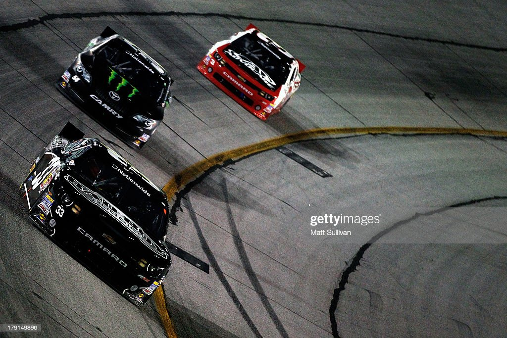 Kevin Harvick, driver of the #33 Bad Boy Buggies Chevrolet, leads Kyle Busch, driver of the #54 Monster Energy Toyota, and Austin Dillon, driver of the #3 AdvoCare Spark Chevrolet, during the NASCAR Nationwide Series Great Clips/Grit Chips 300 at Atlanta Motor Speedway on August 31, 2013 in Hampton, Georgia.