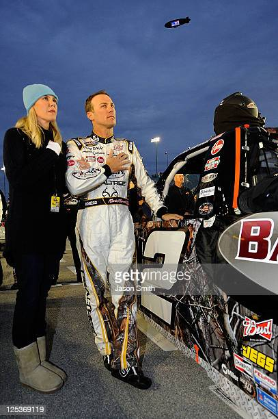 Kevin Harvick driver of the Bad Boy Buggies Chevrolet stands on the grid with his wife DeLana prior to the NASCAR Camping World Truck Series Fast...