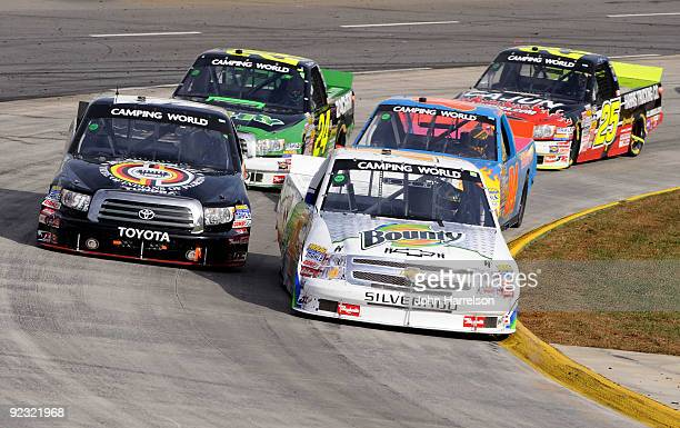 Kevin Harvick driver of the Bounty Chevrolet and Denny Hamlin driver of the Miccosukee Resort Toyota lead a group of trucks during the NASCAR Camping...