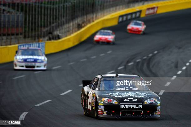 Kevin Harvick driver of the Budweiser Armed Forces Tribute Chevrolet leads Dale Earnhardt Jr driver of the National Guard/Amp Energy Chevrolet during...