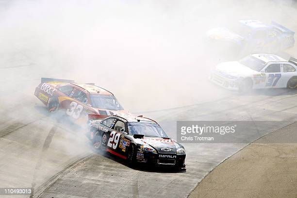 Kevin Harvick driver of the Budweiser Chevrolet and Clint Bowyer driver of the BBT Chevrolet spin out after an incident in the NASCAR Sprint Cup...