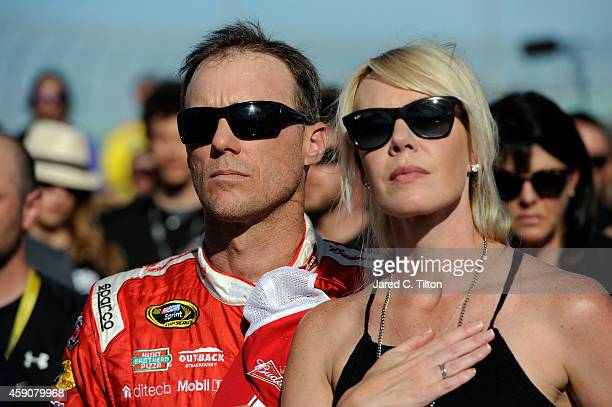 Kevin Harvick, driver of the Budweiser Chevrolet, and his wife DeLana stands on the grid during pre-race ceremonies for the NASCAR Sprint Cup Series...