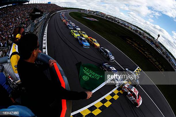 Kevin Harvick, driver of the Budweiser Chevrolet, and Ricky Stenhouse Jr., driver of the Ford EcoBoost Ford, lead the field past the green flag to...