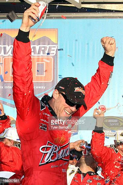 Kevin Harvick driver of the Budweiser Chevrolet celebrates in Victory Lane after winning the NASCAR Sprint Cup Series AdvoCare 500 at Phoenix...