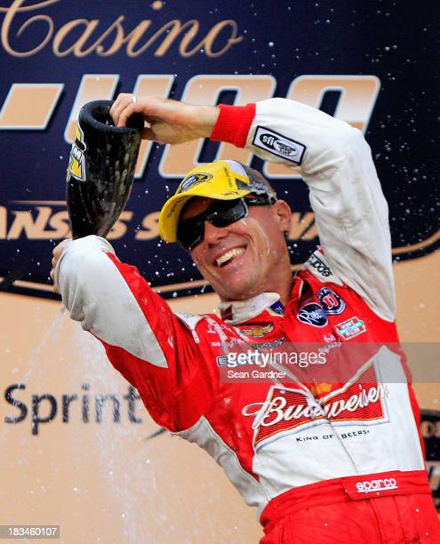 Kevin Harvick, driver of the Budweiser Chevrolet, celebrates in Victory Lane after winning the NASCAR Sprint Cup Series 13th Annual Hollywood Casino...