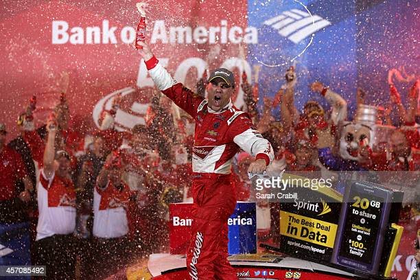 Kevin Harvick, driver of the Budweiser Chevrolet, celebrates in Victory Lane after winning the NASCAR Sprint Cup Series Bank of America 500 at...
