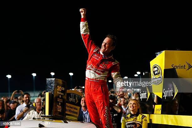 Kevin Harvick driver of the Budweiser Chevrolet celebrates in Victory Lane after winning the NASCAR Sprint Cup Series Ford EcoBoost 400 and the...