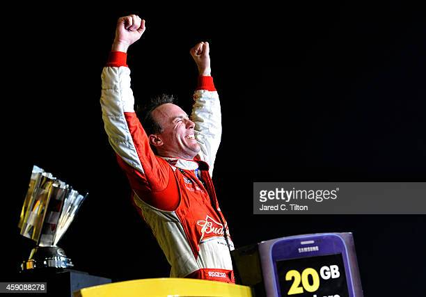Kevin Harvick driver of the Budweiser Chevrolet celebrates in victory lane after winning during the NASCAR Sprint Cup Series Ford EcoBoost 400 at...