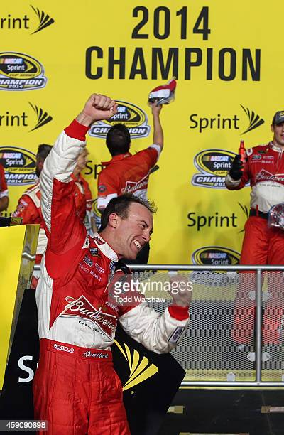 Kevin Harvick driver of the Budweiser Chevrolet celebrates in victory lane after winning the NASCAR Sprint Cup Series Ford EcoBoost 400 at...