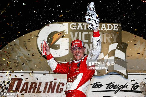 Kevin Harvick, driver of the Budweiser Chevrolet, celebrates in Victory Lane after winning the NASCAR Sprint Cup Series Bojangles' Southern 500 at...