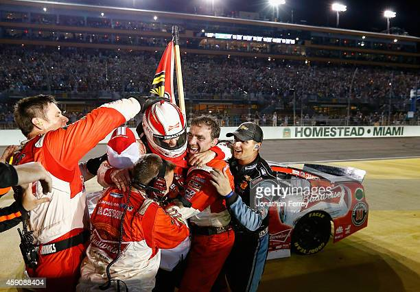 Kevin Harvick, driver of the Budweiser Chevrolet, celebrates winning with his team after the NASCAR Sprint Cup Series Ford EcoBoost 400 at...