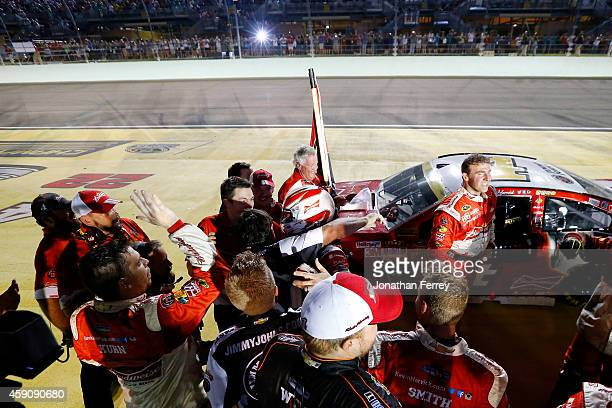 Kevin Harvick driver of the Budweiser Chevrolet celebrates winning with his team after the NASCAR Sprint Cup Series Ford EcoBoost 400 at...