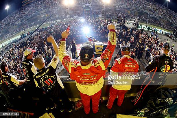 Kevin Harvick, driver of the Budweiser Chevrolet, celebrates winning the series championship in Victory Lane with his team after the NASCAR Sprint...