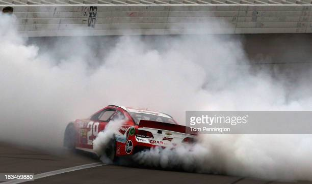 Kevin Harvick, driver of the Budweiser Chevrolet, celebrates with a burnout after winning the NASCAR Sprint Cup Series 13th Annual Hollywood Casino...