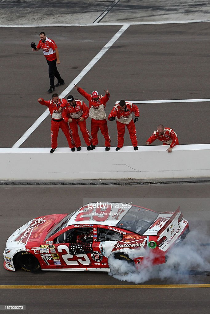 Kevin Harvick, driver of the #29 Budweiser Chevrolet, celebrates with a burnout after winning the NASCAR Sprint Cup Series AdvoCare 500 at Phoenix International Raceway on November 10, 2013 in Avondale, Arizona.