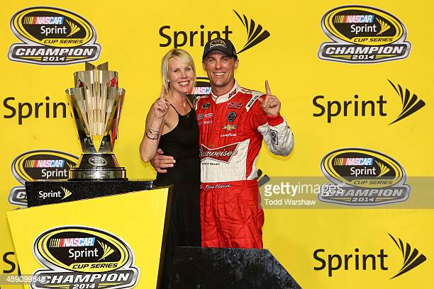 Kevin Harvick, driver of the Budweiser Chevrolet, celebrates with his wife DeLana in Victory Lane after winning the NASCAR Sprint Cup Series Ford...