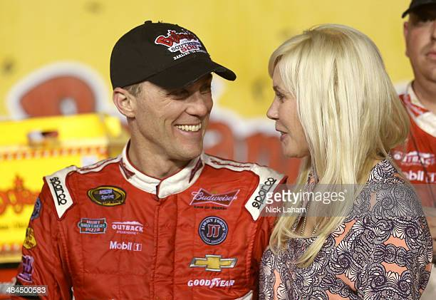 Kevin Harvick, driver of the Budweiser Chevrolet, celebrates with his wife DeLana in Victory Lane after winning the NASCAR Sprint Cup Series...