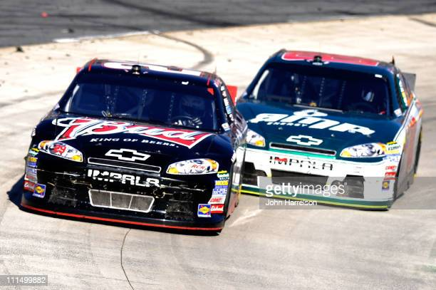 Kevin Harvick driver of the Budweiser Chevrolet leads Dale Earnhardt Jr driver of the Amp Energy/National Guard Chevrolet during the NASCAR Sprint...