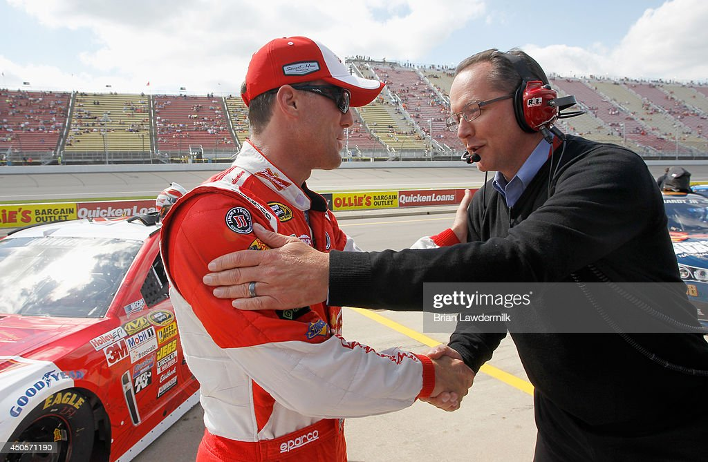 Kevin Harvick, driver of the #4 Budweiser Chevrolet, left, is congratulated by a crew member after qualifying for the pole for the NASCAR Sprint Cup Series Quicken Loans 400 at Michigan International Speedway on June 13, 2014 in Brooklyn, Michigan.