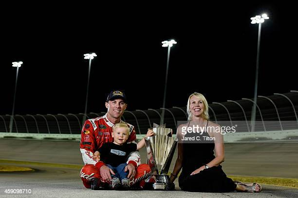 Kevin Harvick, driver of the Budweiser Chevrolet, poses for a portrait with his wife DeLana and son Keelan after winning the NASCAR Sprint Cup Series...