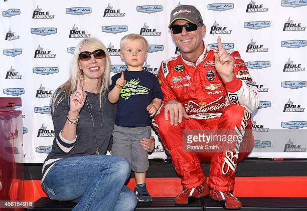 Kevin Harvick, driver of the Budweiser Chevrolet, poses with wife DeLana and son Keelan after qualifying on pole for the NASCAR Sprint Cup Series AAA...