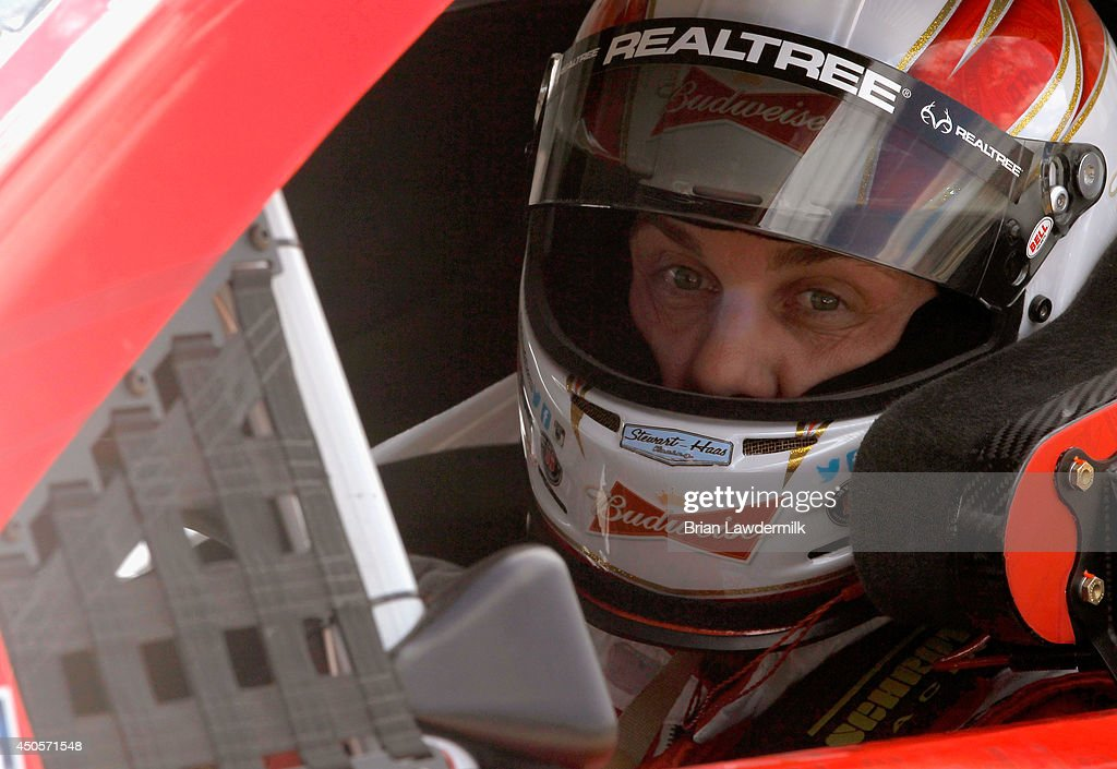 Kevin Harvick, driver of the #4 Budweiser Chevrolet, sits in his car on the grid during qualifying for the NASCAR Sprint Cup Series Quicken Loans 400 at Michigan International Speedway on June 13, 2014 in Brooklyn, Michigan.