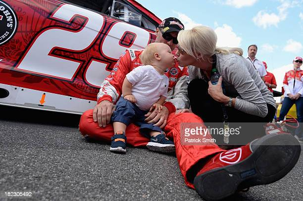 Kevin Harvick driver of the Budweiser Chevrolet sits with son Keelan and wife DeLana on the grid during prerace ceremonies for the NASCAR Sprint Cup...