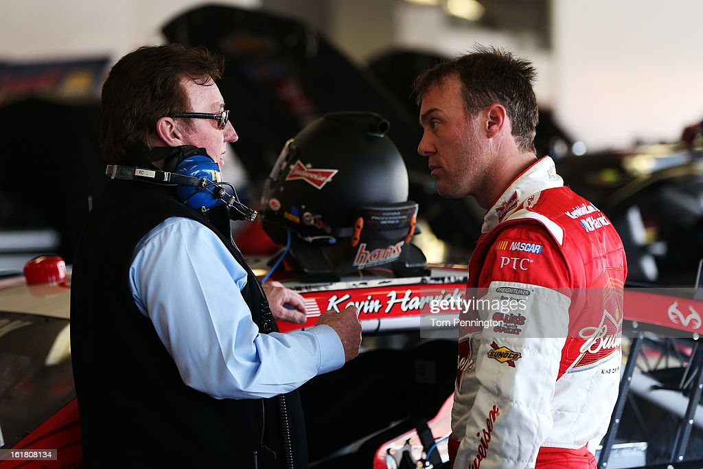 Kevin Harvick, driver of the #29 Budweiser Chevrolet, speaks to team owner Richard Childress during practice for the NASCAR Sprint Cup Series Daytona 500 at Daytona International Speedway on February 16, 2013 in Daytona Beach, Florida.